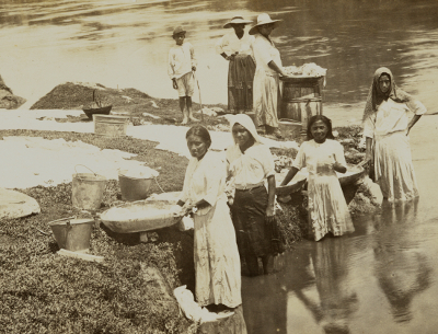 Women washing clothes in the Makal River in San Ignacio Belize